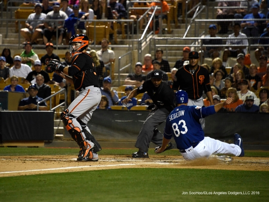 Los Angeles Dodgers Rob Segedin scores during game against the San Francisco Giants Friday, March 25, 2016 at Camelback Ranch-Glendale in Phoenix, Arizona