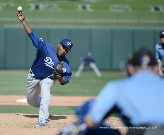 Los Angeles Dodgers Pedro Baez pitches against the Texas Rangers Friday, March 4, 2016 at Surprise Recreation Campus in Surprise, Arizona.