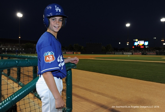 Great Los Angeles Dodgers bat boy during game against the San Francisco Giants Friday, March 25, 2016 at Camelback Ranch-Glendale in Phoenix, Arizona