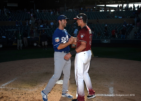 Los Angeles Dodgers Michael Ahmed and Diamondback brother Nick Ahmed greet each other after  game Friday, March 18,2016 at Salt River Fields at Talking Stick