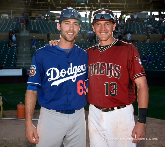 Los Angeles Dodgers Michael Ahmed and Diamondback brother Nick Ahmed pose after  game Friday, March 18,2016 at Salt River Fields at Talking Stick