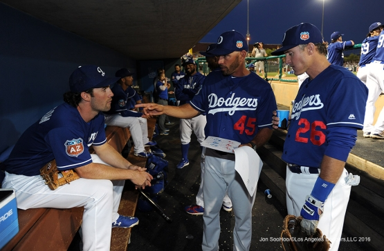 Los Angeles Dodgers Charlie Culbertson, Chris Woodward and Chase Utley in the dugout during game against the San Francisco Giants Friday, March 25, 2016 at Camelback Ranch-Glendale in Phoenix, Arizona