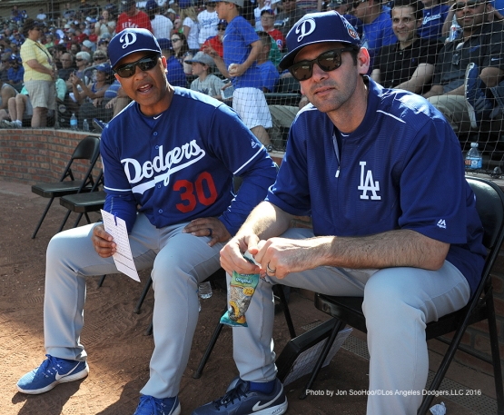 Los Angeles Dodgers Dave Roberts sits with Shawn Green during game against the Texas Rangers Friday, March 4, 2016 at Surprise Recreation Campus in Surprise, Arizona.
