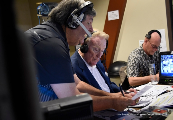 Los Angeles Dodgers Vin Scully assisted by Boyd Robertson in the booth during game against the San Francisco Giants Friday, March 25, 2016 at Camelback Ranch-Glendale in Phoenix, Arizona