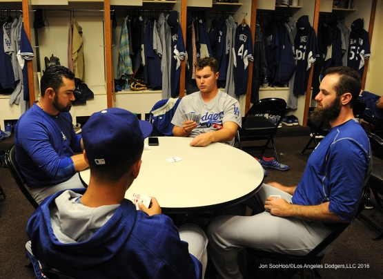 Los Angeles Dodgers Adrian Gonzalez, Joc Pederson, Scott Van Slyke and Austin Barnes play cards during rain delay against the San Francisco Giants Saturday, April 9, 2016 at AT&T Park in San Francisco,California. The Dodgers beat the Giants 3-2.