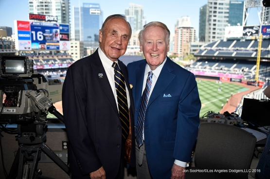 Los Angeles Dodgers Vin Scully poses with San Diego Padres Dick Enberg Monday, April 4, 2016 at Petco Park in San Diego,California. The Dodgers beat the Padres 15-0