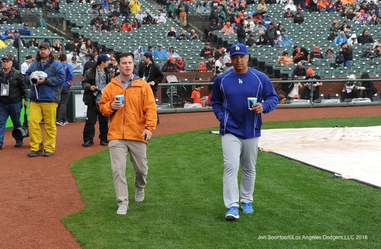 Los Angeles Dodgers Andrew Friedman and Dave Roberts during rain delay against the San Francisco Giants Saturday, April 9, 2016 at AT&T Park in San Francisco,California. The Dodgers beat the Giants 3-2.