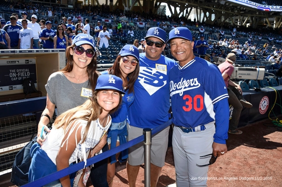 Los Angeles Dodgers Dave Roberts with the Hernandez family prior to game against the San Diego Padres Monday, April 4, 2016 at Petco Park in San Diego,California. The Dodgers beat the Padres 15-0