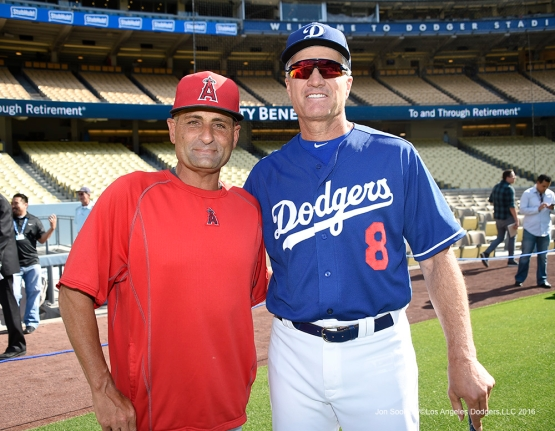 Los Angeles Dodgers coach Bob Geren with Angels Dino Ebels prior to   Thursday, March 31,2016 at Dodger Stadium in Los Angeles,California.