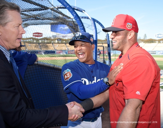 Los Angeles Dodgers Dave Roberts with Angels Albert Pujols prior to game against the Los Angeles Angels of Anaheim Thursday, March 31,2016 at Dodger Stadium in Los Angeles,California.