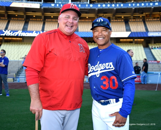 Los Angeles Dodgers Dave Roberts and Angels Mike Scioscia (L) pose prior to  game against the Los Angeles Angels of Anaheim Thursday, March 31,2016 at Dodger Stadium in Los Angeles,California.