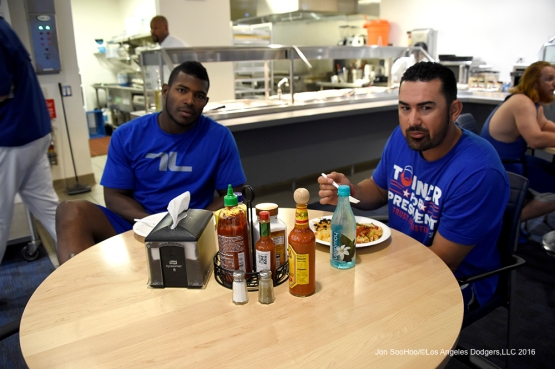 Los Angeles Dodgers Yasiel Puig and Adrian Gonzalez eat prior to game against the Los Angeles Angels of Anaheim Thursday, March 31,2016 at Dodger Stadium in Los Angeles,California.