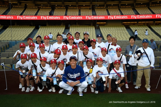 Los Angeles Dodgers Kenta Maeda poses with Little League World Series Champs from Japan prior to game against the Los Angeles Angels of Anaheim Thursday, March 31,2016 at Dodger Stadium in Los Angeles,California.