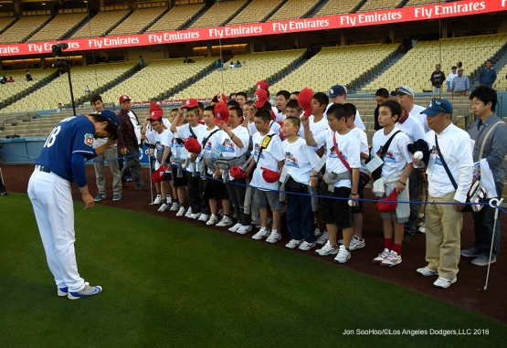 Los Angeles Dodgers Kenta Maeda bows with Little League World Series Champs from Japan prior to game against the Los Angeles Angels of Anaheim Thursday, March 31,2016 at Dodger Stadium in Los Angeles,California.