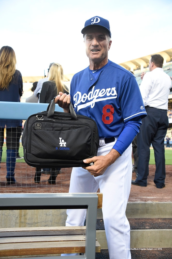 Los Angeles Dodgers coach Bob Geren with his bag prior to game against the Los Angeles Angels of Anaheim Thursday, March 31,2016 at Dodger Stadium in Los Angeles,California.