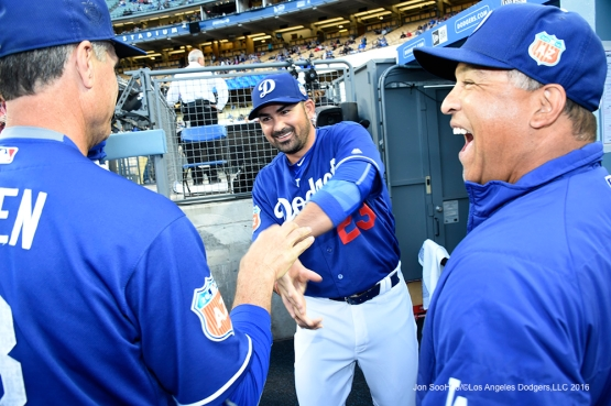Los Angeles Dodgers Adrian Gonzalez shakes hand with Bob Geren and Dave Roberts prior to game against the Los Angeles Angels of Anaheim Thursday, March 31,2016 at Dodger Stadium in Los Angeles,California.