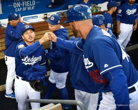 Los Angeles Dodgers Scott Kazamir fist pumps with Chris Woodward prior to game against the Los Angeles Angels of Anaheim Thursday, March 31,2016 at Dodger Stadium in Los Angeles,California.