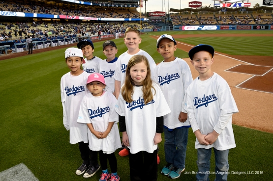 Kids take the field prior to Los Angeles Dodgers game against the Los Angeles Angels of Anaheim Thursday, March 31,2016 at Dodger Stadium in Los Angeles,California.