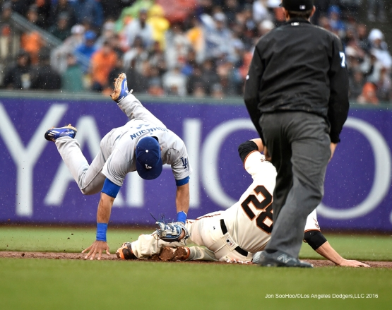 Los Angeles Dodgers Micah Johnson is upended at second base during game against the San Francisco Giants Saturday, April 9, 2016 at AT&T Park in San Francisco,California. The Dodgers beat the Giants 3-2.