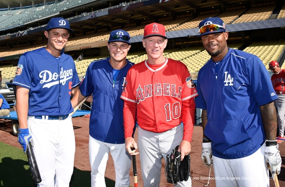 Corey Seager, Joc Pederson, Ron Roenicke and Carl Crawford pose Friday, April 1, 2016 at Dodger Stadium in Los Angeles,California.