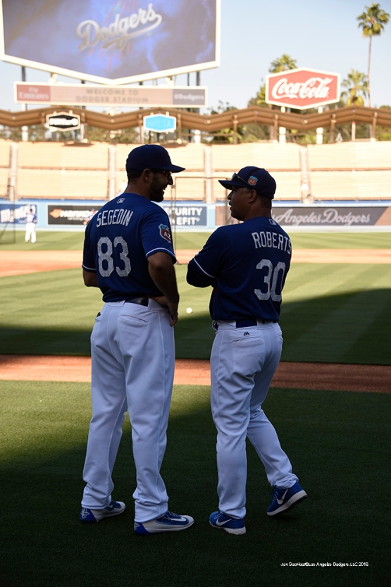 Los Angeles Dodgers Dave Roberts and Rob Segedin prior to game against the Los Angeles Angels of Anaheim Friday, April 1, 2016 at Dodger Stadium in Los Angeles,California.