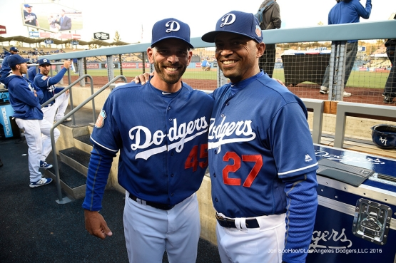 Los Angeles Dodgers Chris Woodward and George Lombard prior to game against the Los Angeles Angels of Anaheim Friday, April 1, 2016 at Dodger Stadium in Los Angeles,California.