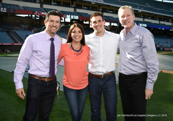 Nomar Garciaparra, Alanna Rizzo, Joe Davis and Orel Hershiser pose Saturday, April 2, 2016 at Angels Stadium in Anaheim,California.