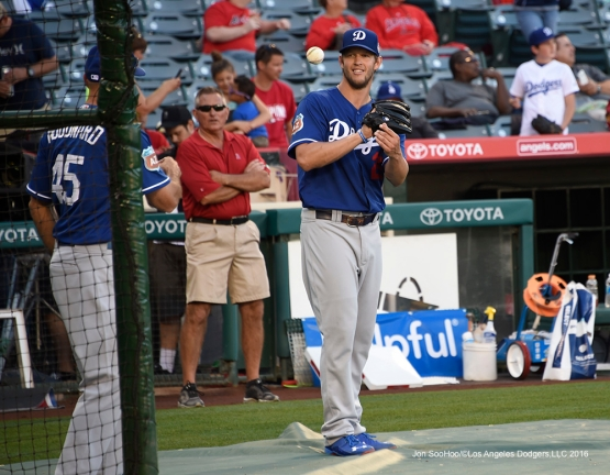 Los Angeles Dodgers Clayton Kershaw helps out prior to  game against the Los Angeles Angels of Anaheim Saturday, April 2, 2016 at Angels Stadium in Anaheim,California.