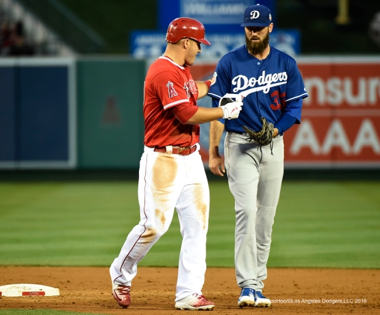 Los Angeles Dodgers Scott Van Slyke helps out  Angels Mike Trout during game Saturday, April 2, 2016 at Angels Stadium in Anaheim,California.