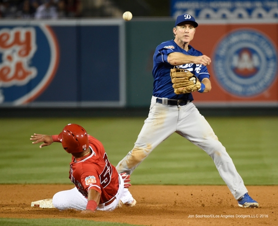 Los Angeles Dodgers Chase Utley throws to first during game against the Los Angeles Angels of Anaheim Saturday, April 2, 2016 at Angels Stadium in Anaheim,California.