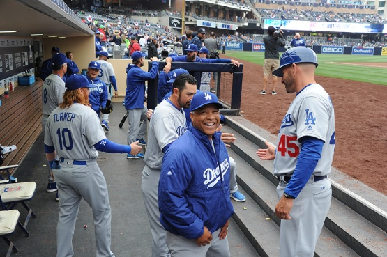 Los Angeles Dodgers Dave Roberts laughs with Chris Woodward prior to game against the San Diego Padres Wednesday, April 6, 2016 at Petco Park in San Diego,California. The Dodgers beat the Padres
