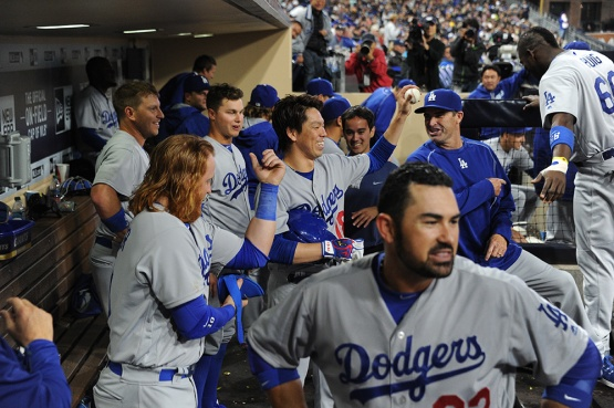 Los Angeles Dodgers Kenta Maeda is swarmed by teammates after homer against the San Diego Padres Wednesday, April 6, 2016 at Petco Park in San Diego,California. The Dodgers beat the Padres