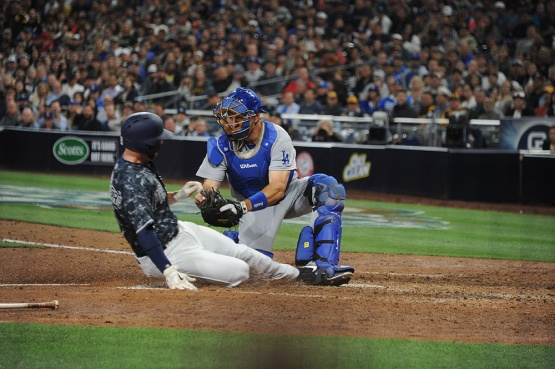 Los Angeles Dodgers A.J.Ellis makes the tag during game against the San Diego Padres Wednesday, April 6, 2016 at Petco Park in San Diego,California. The Dodgers beat the Padres