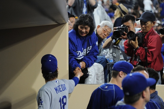 Los Angeles Dodgers Kenta Maeda is congratulated by Dave Roberts mom during game against the San Diego Padres Wednesday, April 6, 2016 at Petco Park in San Diego,California. The Dodgers beat the Padres