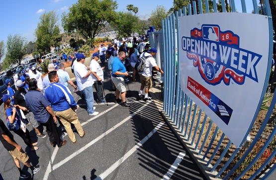 Dodger fans enter the stadium for the Los Angeles Dodgers home opener at Dodger Stadium on April 12, 2016.