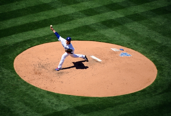 Dodgers starter Kenta Maeda throws to the plate.