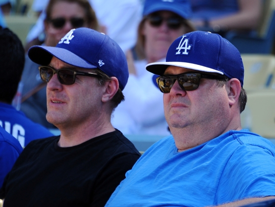 Actor Eric Stonestreet (right) watches the game between the D'Backs and Dodgers.