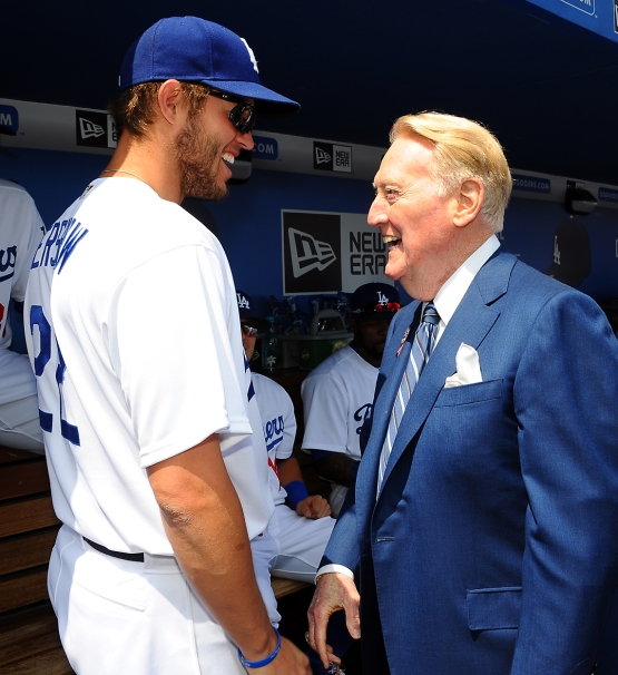 Clayton Kershaw (left) talks with Vin Scully before the game.