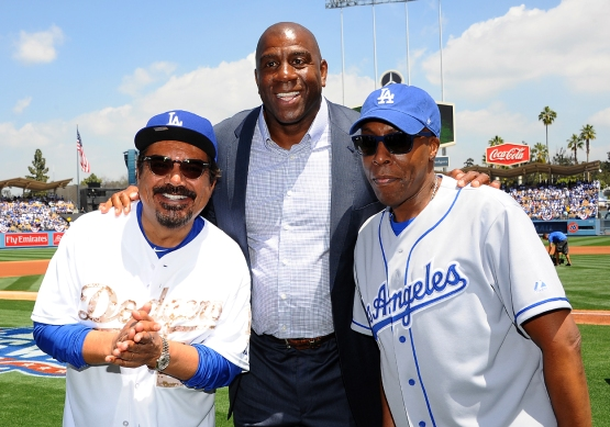 "George Lopez, Earvin ""Magic"" Johnson and Arsenio Hall pose for a photo."