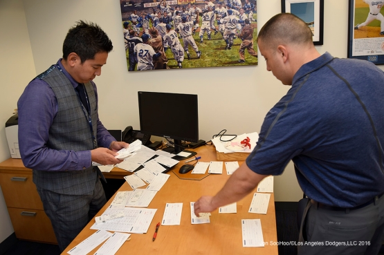 Scott Akasaki and Alex Torres work prior to Los Angeles Dodgers game against the Arizona Diamondbacks Tuesday, April 12, 2016 at Dodger Stadium.