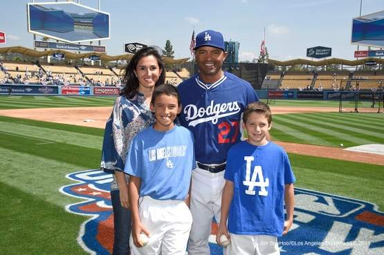 Los Angeles Dodgers Coach George Lombard poses with his family prior to game against the Arizona Diamondbacks Tuesday, April 12, 2016 at Dodger Stadium.