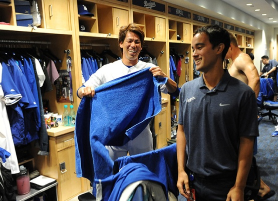 Los Angeles Dodgers Kenta Maeda and translator Will Ireton prepare for game against the Arizona Diamondbacks Tuesday, April 12, 2016 at Dodger Stadium.