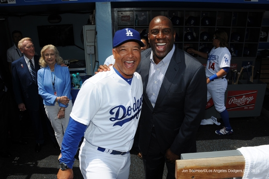 Los Angeles Dodgers Dave Roberts and Magic Johnson pose prior to game against the Arizona Diamondbacks Tuesday, April 12, 2016 at Dodger Stadium.