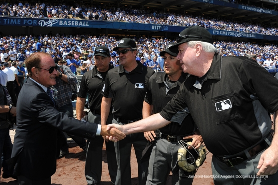 Al Michaels greets the Umpires prior to Los Angeles Dodgers game against the Arizona Diamondbacks Tuesday, April 12, 2016 at Dodger Stadium.