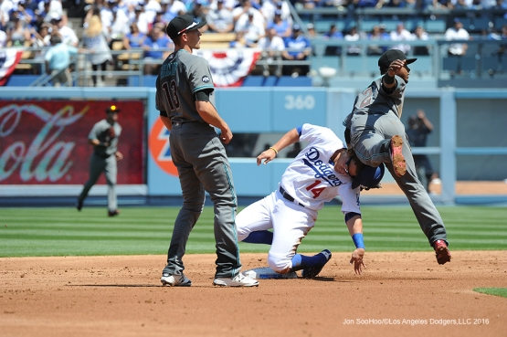 Los Angeles Dodgers Kike Hernandez breaks up double play during game against the Arizona Diamondbacks Tuesday, April 12, 2016 at Dodger Stadium.