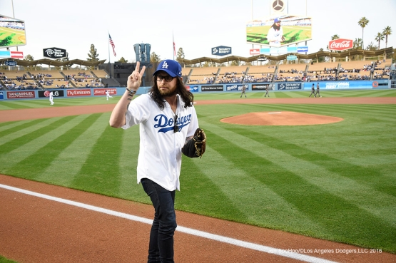 Kings of Leon Drummer Nathan Followill throws out the ceremonial first pitch prior to Los Angeles Dodgers game against Arizona Diamondbacks Thursday, April 14, 2016 at Dodger Stadium.