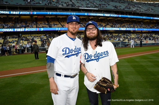 Kings of Leon Drummer Nathan Followill poses with catcher Yasmani Grandal after throwing out the ceremonial first pitch before Los Angeles Dodgers game against Arizona Diamondbacks Thursday, April 14, 2016 at Dodger Stadium.
