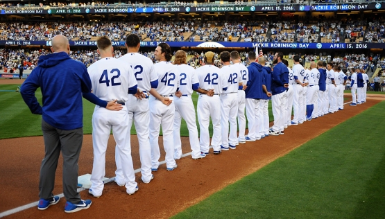 Los Angeles Dodgers players line up during the national anthem during Jackie Robinson Day before the game against the San Francisco Giants.