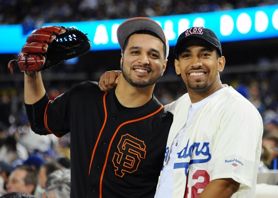 A Giants and Dodgers fan pose for a photo.