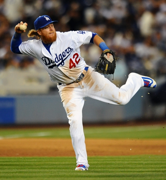 Justin Turner fields the ball and looks to throw to first base.